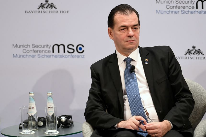 In a photo taken on Feb 16, 2020, Romania's Prime Minister Ludovic Orban listens during a panel discussion at the annual Munich Security Conference in Germany.