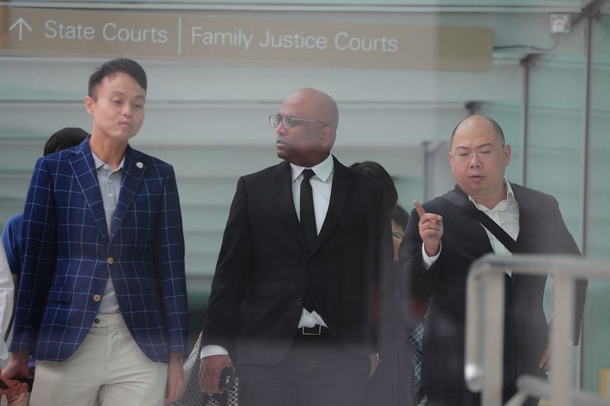 (From left) Mr Daniel Augustin De Costa, lawyer M. Ravi and TOC editor Terry Xu outside the State Courts on Jan 20, 2020.
