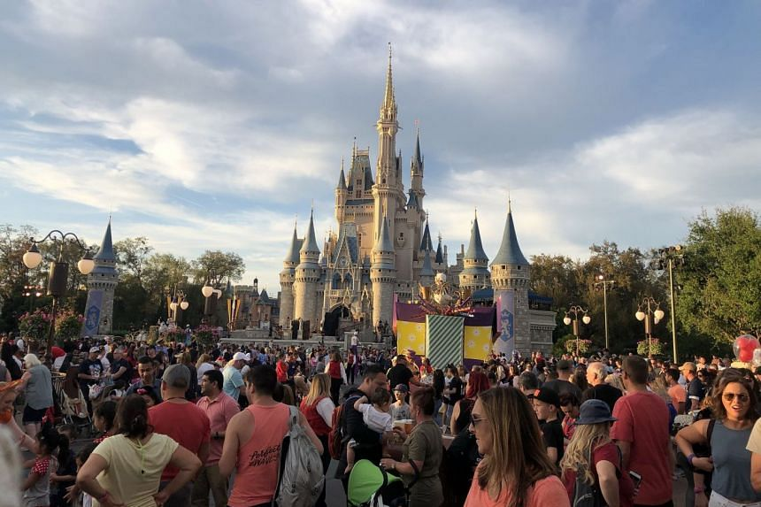 Disney World attendees walk through Magic Kingdom, March 6, 2020.