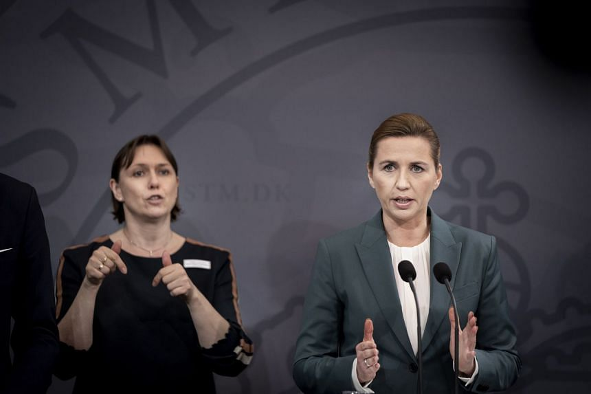 Danish Prime Minister Mette Frederiksen (right) holds a press briefing on the Covid-19.