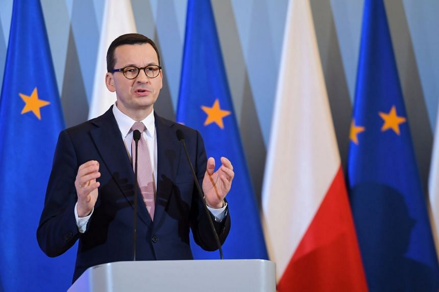 Polish Prime Minister Mateusz Morawiecki speaks during a press conference on the coronavirus in Warsaw.