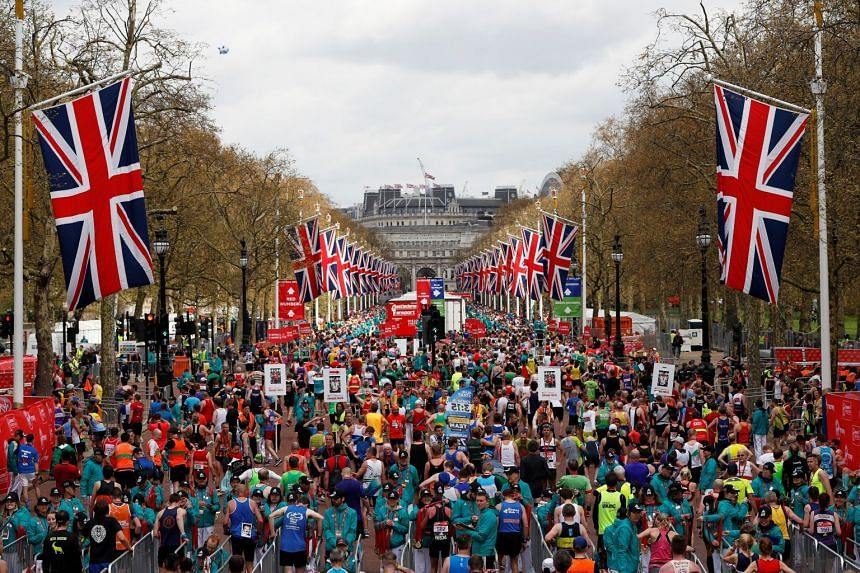 A 2016 photo shows runners collecting their medals after finishing the London Marathon.