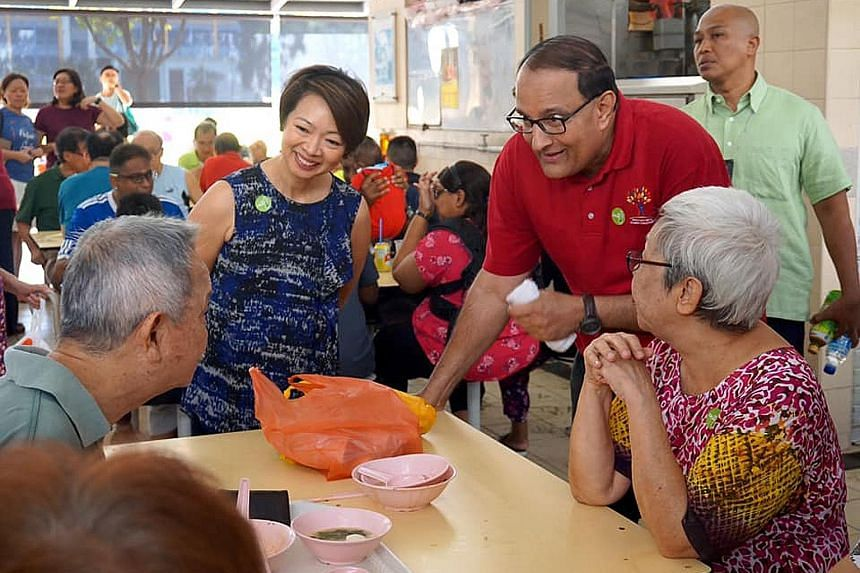 West Coast GRC MPs S. Iswaran and Foo Mee Har speaking with residents in Telok Blangah. The Progress Singapore Party, led by former People's Action Party backbencher Tan Cheng Bock, is widely expected to contest the GRC.