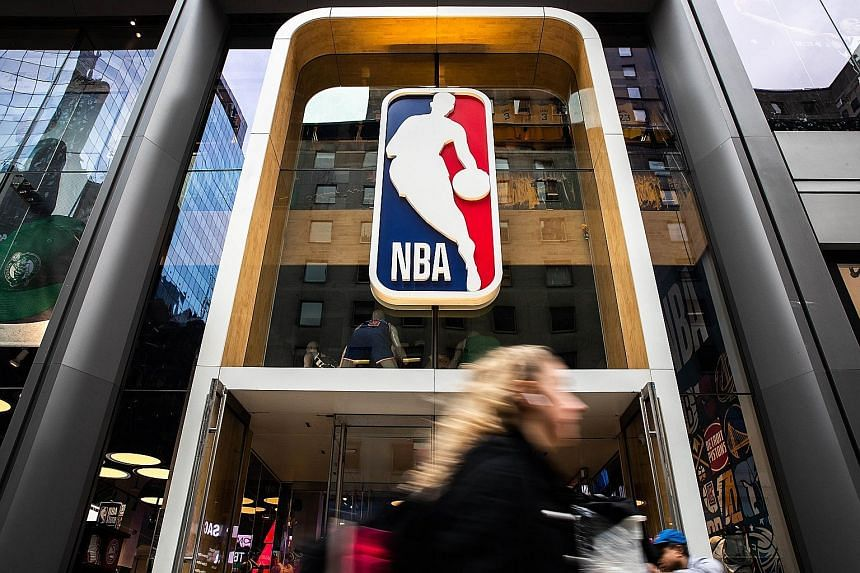 A National Basketball Association store on Fifth Avenue in New York City. The NBA was the first major North American sport to suspend its season after a player tested positive for the coronavirus. PHOTO: AGENCE FRANCE-PRESSE