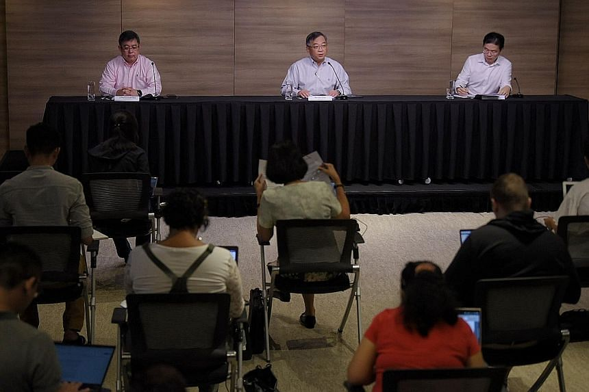 (From right) National Development Minister Lawrence Wong, Health Minister Gan Kim Yong and Ministry of Health director of medical services Kenneth Mak walking the talk on social distancing at yesterday's press conference on the local Covid-19 situati