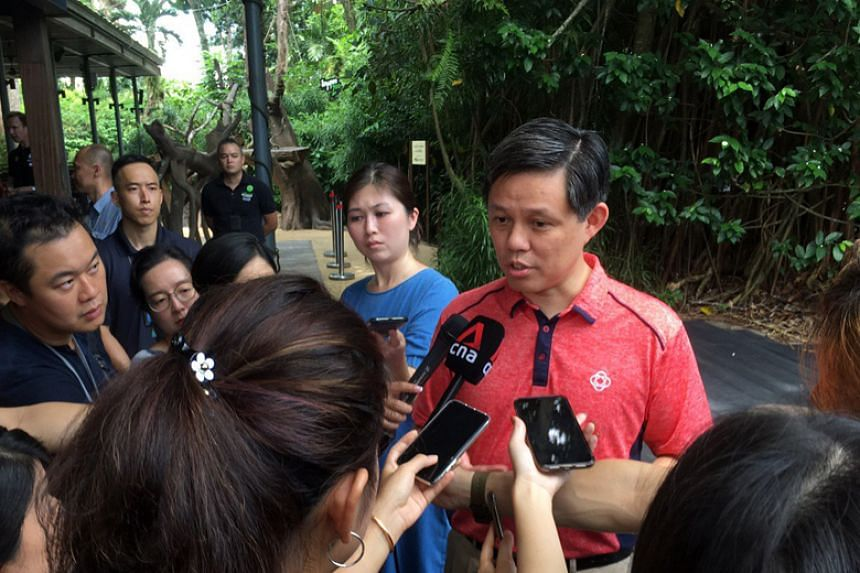Trade and Industry Minister Chan Chun Sing speaking to reporters on the sidelines of an event at the Singapore Zoo on March 14, 2020.