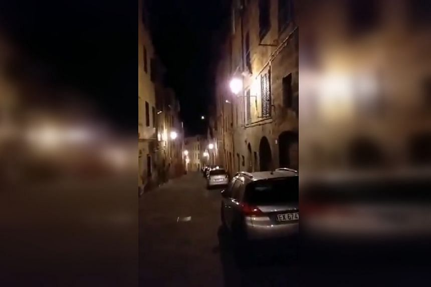 A screenshot from a viral online video of an empty street in Siena where residents can be heard singing.