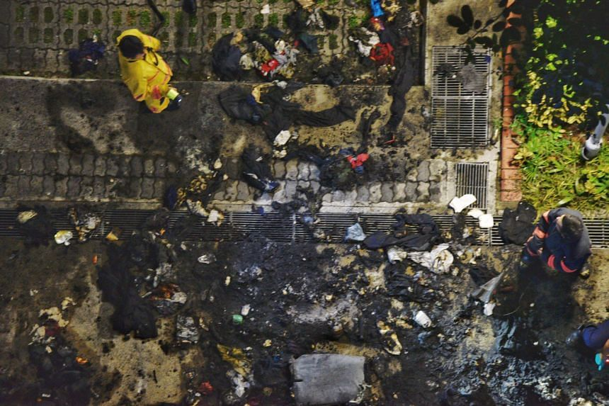 An aerial shot of debris and damage from the fire outside the police post.
