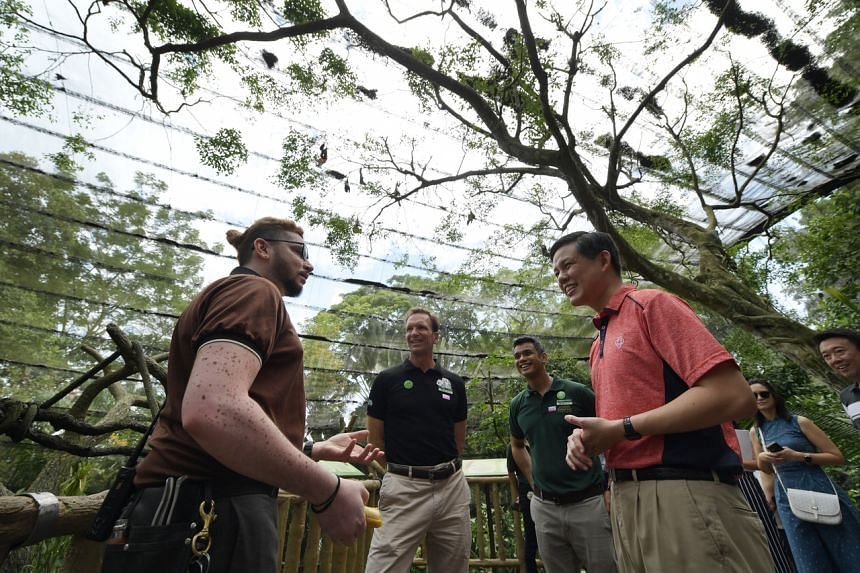 Minister for Trade and Industry Chan Chun Sing (right) speaking with Wildlife Reserves Singapore deputy head keeper Jagan Thanapal and Mandai Park Holdings group chief executive Mike Barclay at the Singapore Zoo on March 14, 2020.