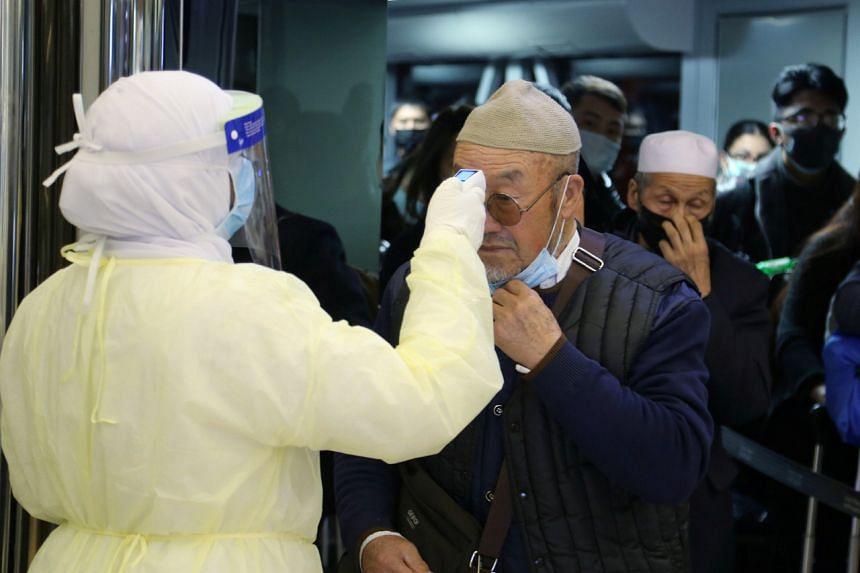 Passengers being screened upon their arrival at King Khalid International Airport in Riyadh, Saudi Arabia, on Jan 29, 2020.