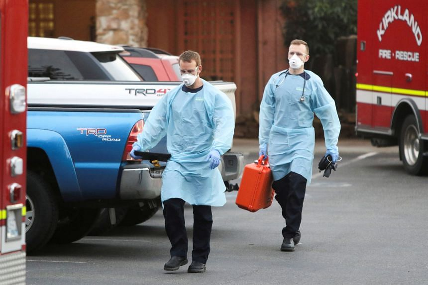 Medical personnel walking out of the Life Care Center of Kirkland, the nursing home in Washington state linked to several coronavirus cases, on March 10, 2020.
