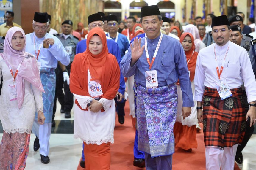 Umno deputy president Mohamad Hasan (second from right) at the opening of the party's Women, Youth and Puteri (Young Women) wings on Dec 4, 2019.