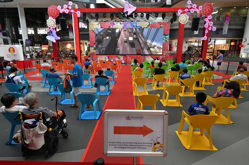 Social distancing during a movie screening at Our Tampines Hub on March 14, 2020.