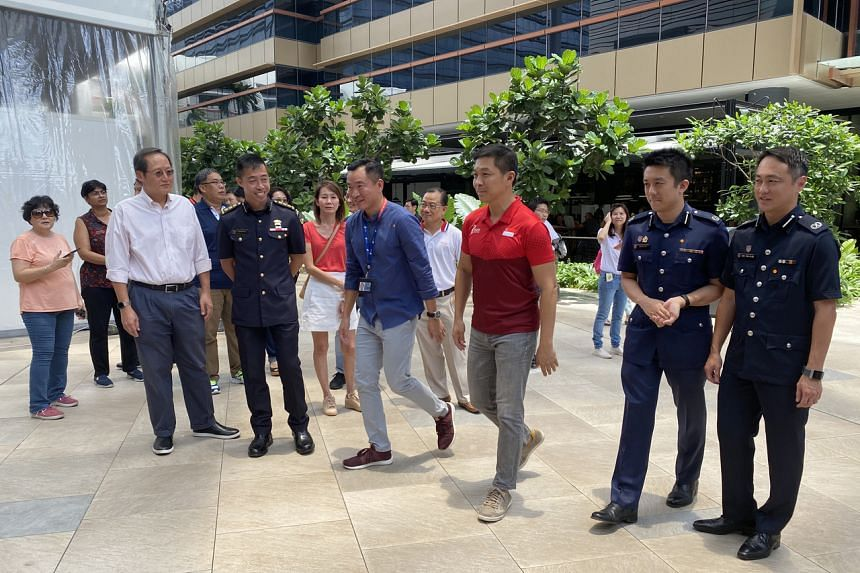 Speaker of Parliament Tan Chuan-Jin (third from right) arriving at an SGSecure roadshow outside the Paya Lebar Quarter mall on March 14, 2020.