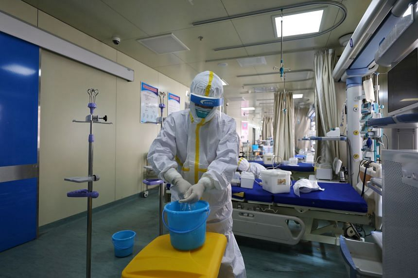 A hospital ward being cleaned in Wuhan on Thursday. With the outbreak in China appearing to be getting under control as the US struggles with its response, Beijing is pushing the narrative that it has claimed victory over the virus.
