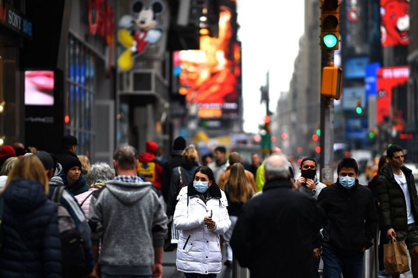 Tourists walking through Times Square in New York City on March 13, 2020. Experts say a variety of factors can lead to an individual infecting many.
