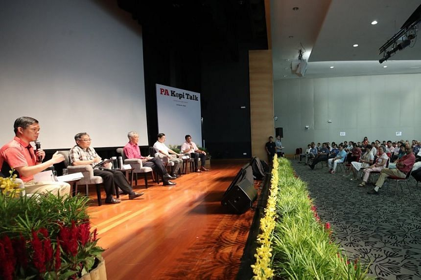 (From left) Trade and Industry Minister Chan Chun Sing, Health Minister Gan Kim Yong, Prime Minister Lee Hsien Loong and National Development Minister Lawrence Wong at ITE College Central on March 14, 2020.