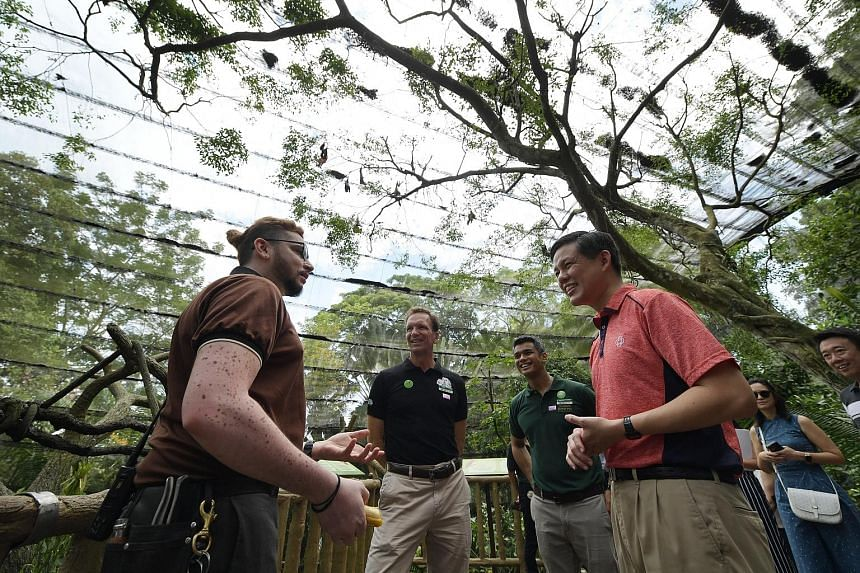 Minister for Trade and Industry Chan Chun Sing speaking to Wildlife Reserves Singapore (WRS) deputy head keeper Jagan Thanapal during his visit to the Singapore Zoo yesterday, as Mandai Park Holdings group chief executive Mike Barclay and WRS chief h