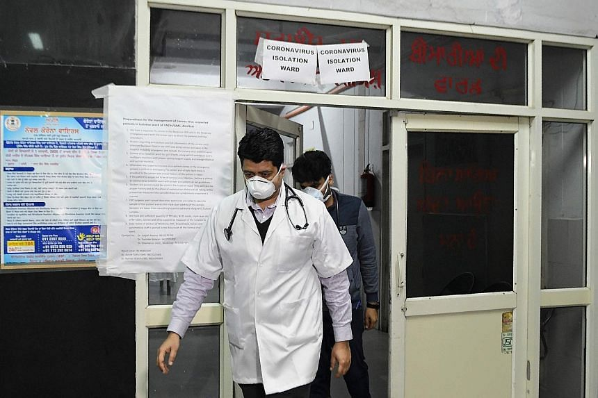 Doctors in front of an isolation ward for coronavirus patients at Guru Nanak Dev Hospital in Amritsar, India, on March 7. India has set up 52 testing stations and is creating more such facilities.