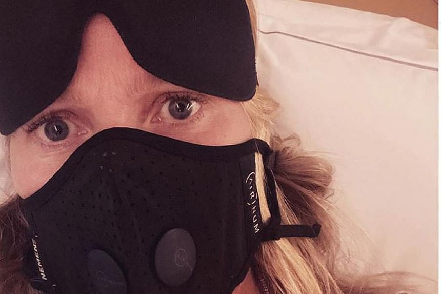 Actress Gwyneth Paltrow on a plane to Paris, wearing a pricey face mask that features five layers of filtration.