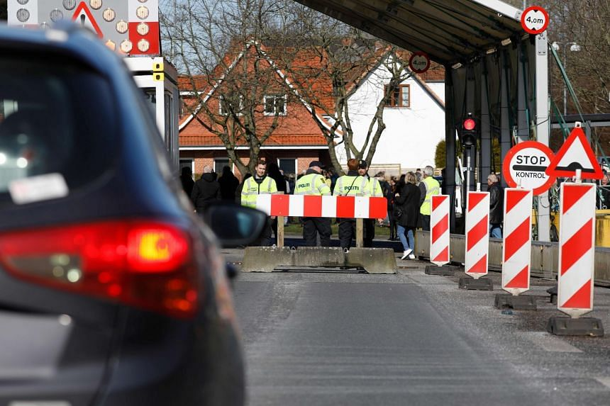 Danish police officers guard the now closed Danish-German border crossing on March 14, 2020.