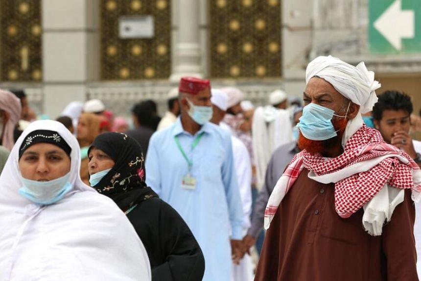 Muslim worshippers circumambulate the sacred Kaaba in Mecca's Grand Mosque, Islam's holiest site, in Saudi Arabia, on March 13, 2020.