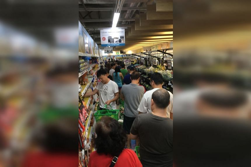 Shoppers buying food products at Bukit Panjang NTUC on March 16, 2020.