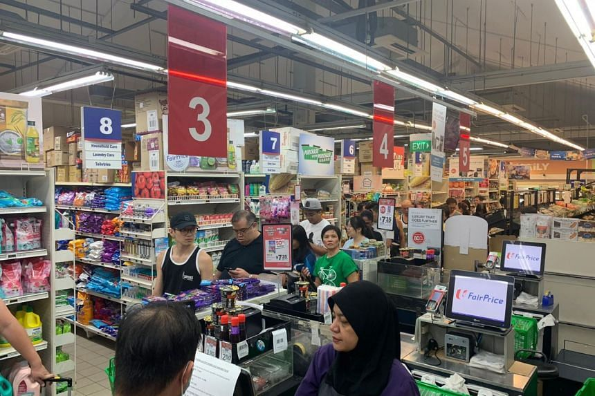Shoppers at NTUC in Block 414, Yishun Ring Road on March 16, 2020. Trade and Industry Minister Chan Chun Sing said the Republic is not facing any immediate risks of running out of food or other supplies brought in by retailers.