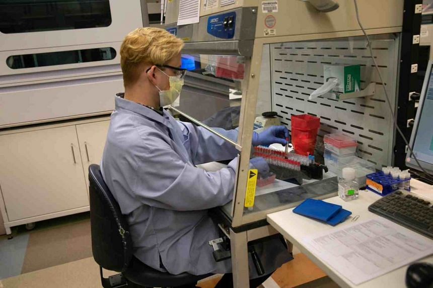 A scientist tests vials for the coronavirus at the University of Washington Medicine virology lab, on March 13, 2020, in Seattle, Washington.