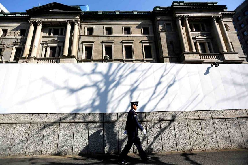 A man walks past the Bank of Japan headquarters in Tokyo, on Jan 23, 2019.