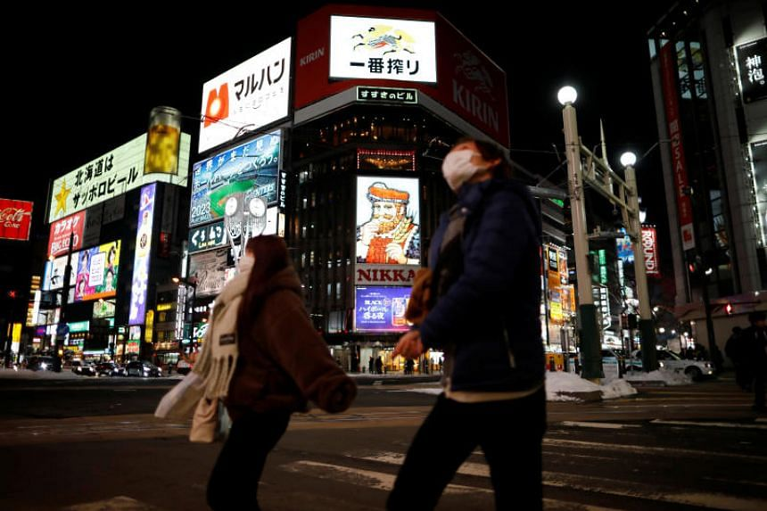 Passersby wearing masks are seen on the street at Susukino district in Sapporo, Japan, on Feb 26, 2020.