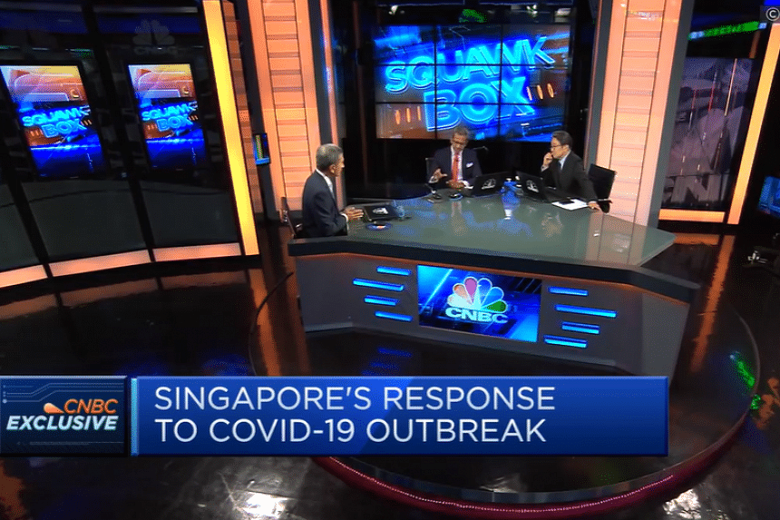 """Foreign Minister Vivian Balakrishnan (left) told CNBC's Sri Jegarajah and Martin Soong on March 11, 2020, that Covid-19 and its economic aftermath is going to last """"at least a year, which means anything we do needs to be sustainable and sensible for"""