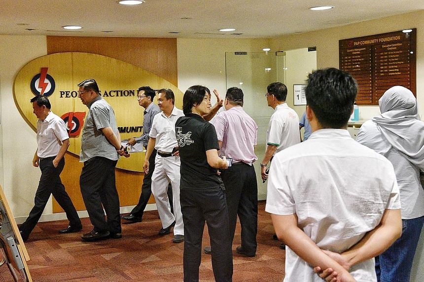 Senior People's Action Party cadres at the party's headquarters in Bedok last Friday. They had met that evening, hours after the new electoral boundaries were announced.