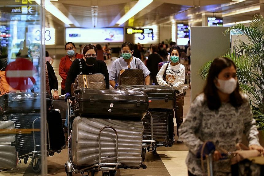 Indonesian travellers arriving at Changi Airport from Jakarta yesterday. Some said they had rushed to book the next flight to Singapore following the announcement on Sunday that Asean nationals will have to obtain the approval of the Ministry of Heal
