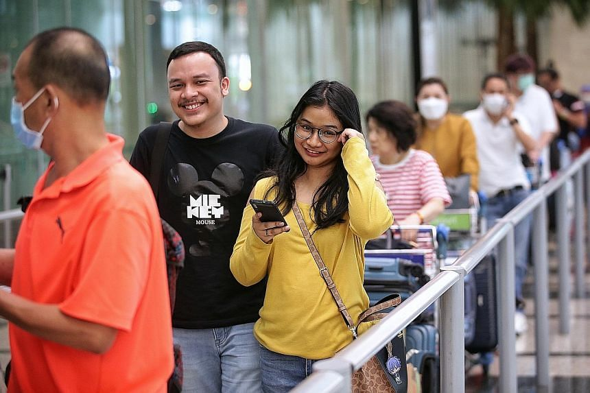 Ms Nadine at Changi Airport yesterday with her husband, Mr Rama, who was there to pick her up. The 25-year-old Indonesian jumped on a flight to Singapore to visit her husband, who has been training to be a pilot here since last month, before the new