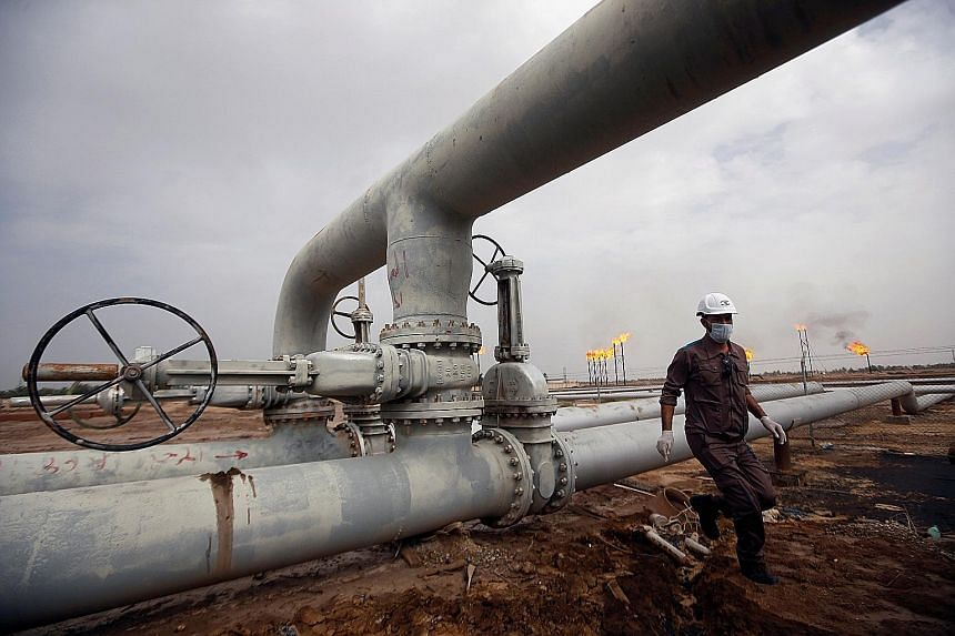 The Nahr Bin Umar oil field north of Basra city in Iraq. Oil traders, executives, hedge fund managers and consultants are revising down their estimates for global oil demand. The growing fear is that consumption, which averaged just over 100 million