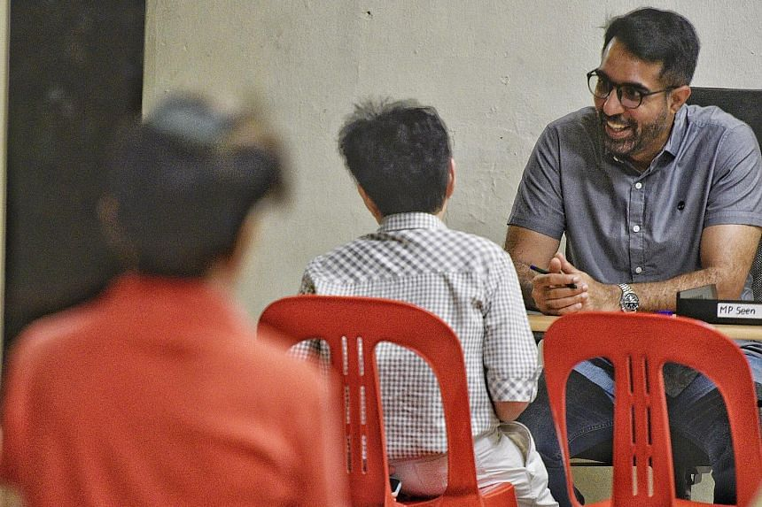 Workers' Party chief Pritam Singh, an MP for Aljunied GRC, at his Meet-the-People Session in Bedok Reservoir Road yesterday. He said the party will continue with house visits, but has limited the number of people at such visits and during other activ