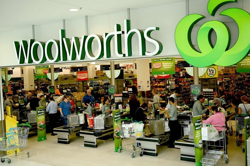 People shop at a Woolworths supermarket in Sydney on March 17, 2020.