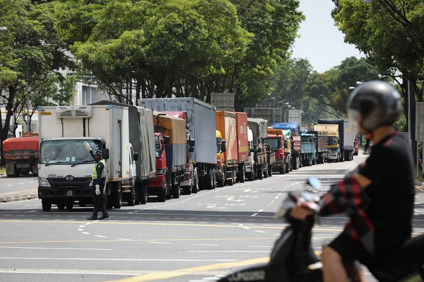 Goods vehicles at a traffic junction near the Woodlands Checkpoint, on March 17, 2020.