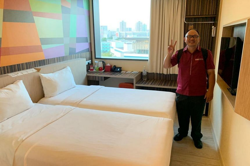SMRT bus driver Lim Kheng Toh, who is among the 2,500 Malaysian public transport workers who are staying in Singapore over the next two weeks, has been allocated a room at a hotel in Jurong.
