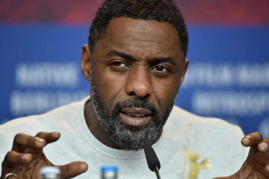 """British actor Idris Elba, a star of """"Avengers: Infinity War,"""" said in a Twitter posting that he had no symptoms so far but was isolating himself from others."""