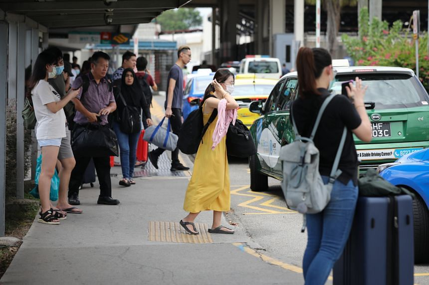 Commuters arriving in Singapore from Malaysia, near the Woodlands Train Checkpoint on March 17, 2020.
