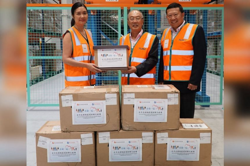 10,000 surgical masks were handed to director of projects at the Ministry of Health's director of medical services office, Dr Elaine Tan (left), by SCBA president James Ow Chin Seng (centre) and SCCCI secretary-general Lu Cheng Yang on March 12, 2020