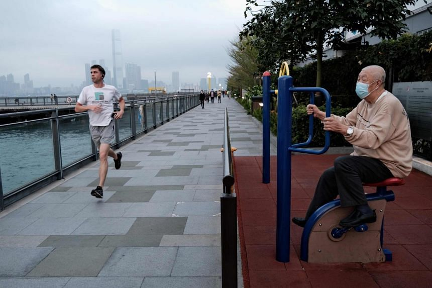 An elderly man wears a face mask as he exercises in Hong Kong on March 16, 2020.