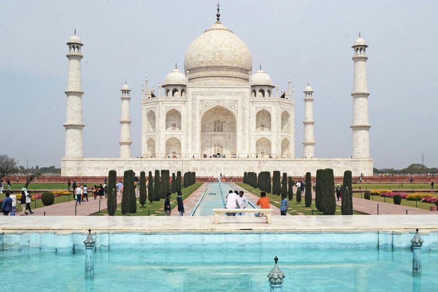 Tourists seen at the Taj Mahal in Agra on March 16, 2020.