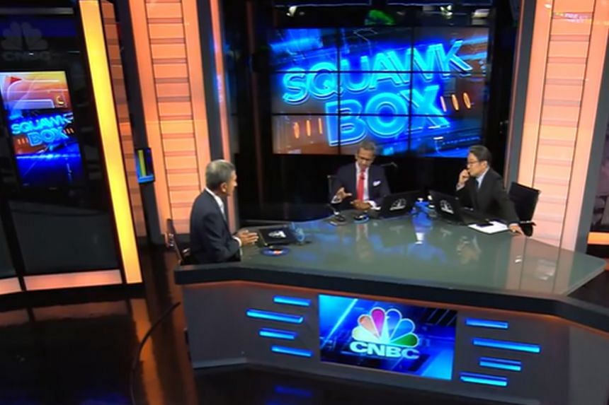 Foreign Minister Vivian Balakrishnan (left) during his interview with CNBC Asia presenters Sri Jegarajah and Martin Soong last Wednesday. He called for action at the global and regional level to tackle the coronavirus crisis, saying ''we cannot resol