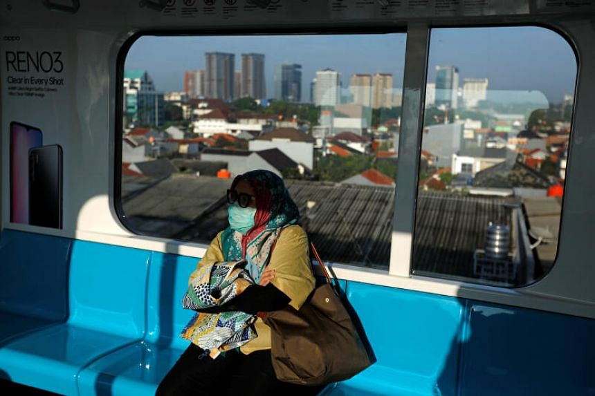 A commuter on a Mass Rapid Transit train in Jakarta, Indonesia, on March 17, 2020. Worries, however, are mounting that if Covid-19 hits the poor or densely-populated areas, the contagion would be much harder to contain.