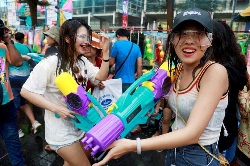 People play with water guns during Songkran Water Festival to celebrate Thai New Year, in Bangkok, Thailand, on April 14, 2019.
