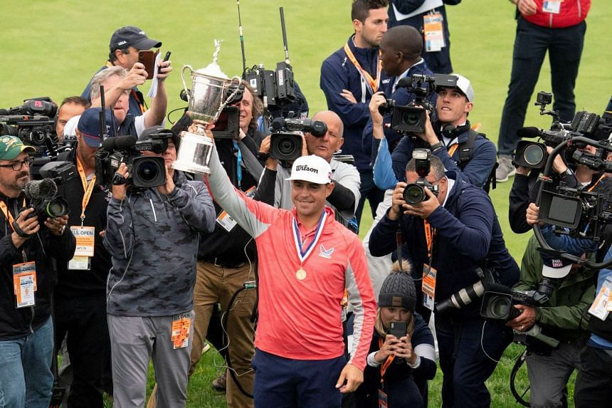 US Open 2019 winner Gary Woodland poses with the trophy.