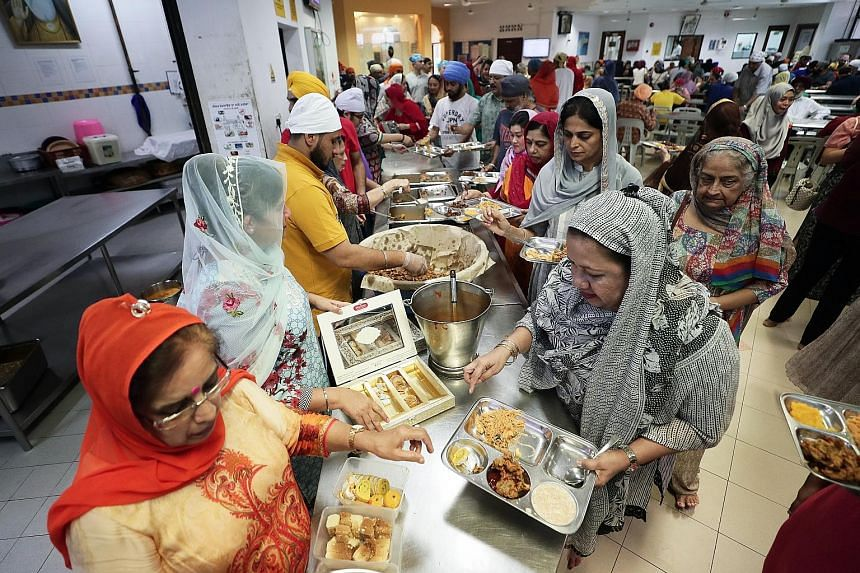 Food catering for visitors and devotees in a sacred religious practice known as langar (left) will be suspended at the Silat Road Sikh Temple and the Central Sikh Temple over the next four weeks, although an exception will be made for weddings. ST PH